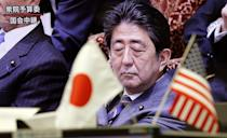 A TV shows Japanese Prime Minister Shinzo Abe listening to a question at Diet session, at a foreign exchange brokerage in Tokyo, Wednesday, Feb. 1, 2017. Japanese officials have rejected U.S. President Donald Trump's suggestion that Tokyo is seeking to weaken the yen against the U.S. dollar to gain a trade advantage. (AP Photo/Shizuo Kambayashi)