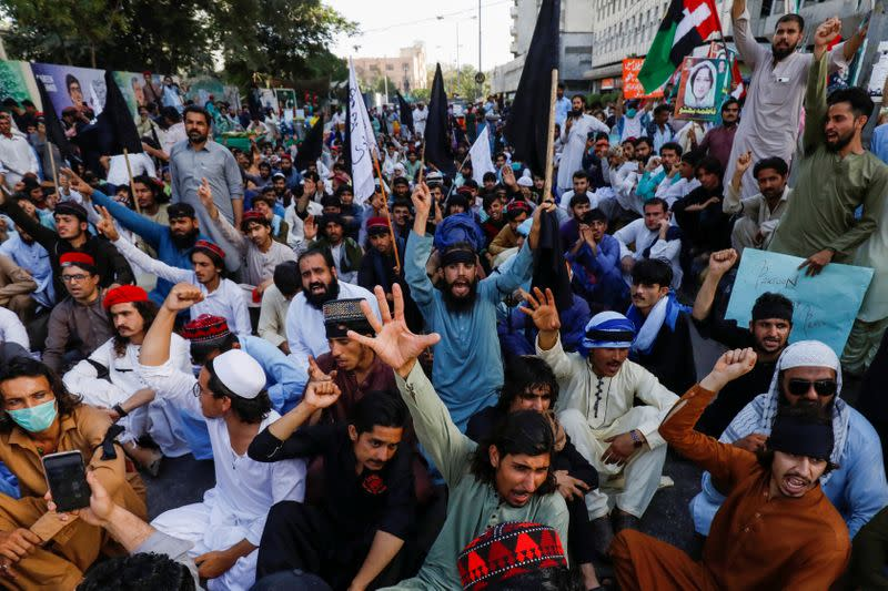 People chant slogans demanding an investigation following the deaths of four teenagers in Jani Khel area in Bannu District of Khyber Pakhtunkhwa (KPK) province, during a protest in Karachi,