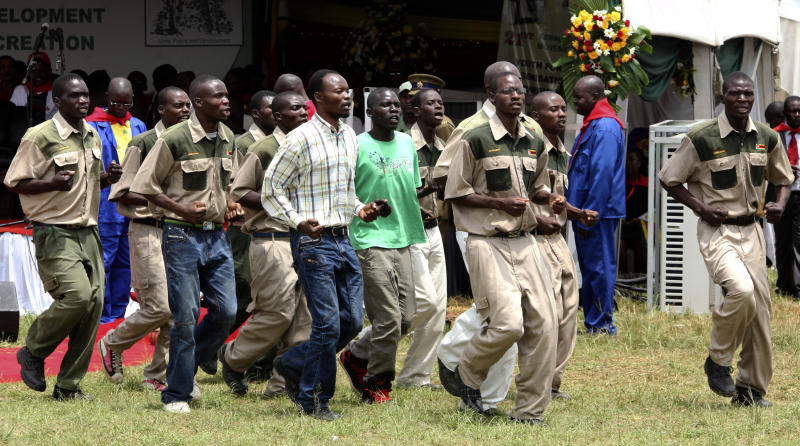 In this photo taken March 2, 2013, members of the ZANU-PF youth  group, popularly known as Chipangano (meaning the brotherhood in local slang) perform at President Robert Mugabe's 89th birthday celebrations in Bindura, Zimbabwe. Elections in Zimbabwe are still months away, but already President Robert Mugabe's party is intimidating its opponents and threatening violence, human rights and pro-democracy groups say. Witnesses say Mugabe's ZANU-PF party has begun deploying youth militia groups in some of its strongholds. (AP Photo/Tsvangirayi Mukwazhi)