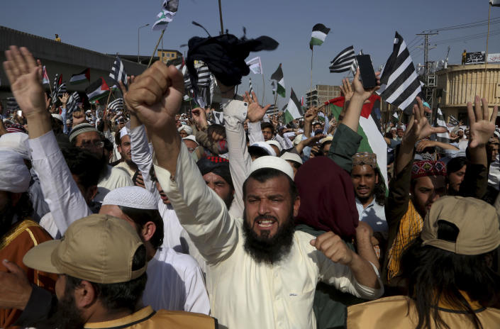 Supporters of the Pakistani religious group' Jamiat Ulema-e Islam chant slogans during a rally in support of Palestinians, in Peshawar, Pakistan, Friday, May 21, 2021. (AP Photo/Muhammad Sajjad)
