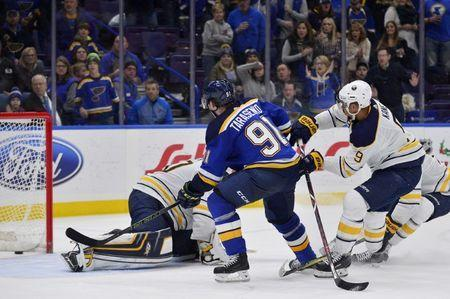 Dec 10, 2017; St. Louis, MO, USA; St. Louis Blues right wing Vladimir Tarasenko (91) shoots and scores against Buffalo Sabres goalie Robin Lehner (40) during overtime at Scottrade Center. Mandatory Credit: Jeff Curry-USA TODAY Sports