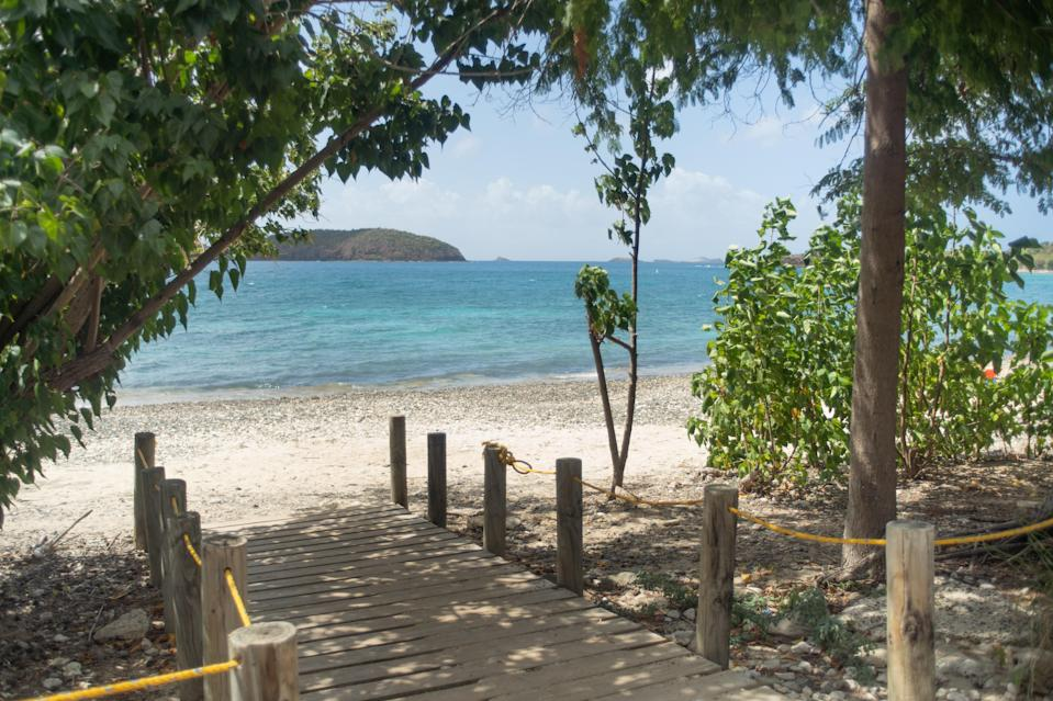 """<p><strong>Give us the wide-angle view: what kind of beach are we talking about?</strong> While the shore is a bit rocky, this is a quiet and secluded beach and a snorkeler's delight. Turtles and tropical fish abound. This is also the water to visit with a kayak or paddle board. The vistas, too, are picturesque—one feels like they've stepped into a postcard.</p> <p><strong>How accessible is it?</strong> Culebra as a whole is a tiny island, but renting a Jeep is recommended if one wants to get around easily. Golf carts are also available, but there are many hills that will be difficult to traverse. For getting to this beach alone, though, a golf cart will suffice.</p> <p><strong>Decent services and facilities, would you say?</strong> This is a beach for those who have brought their own supplies or have rented them elsewhere on the island. It's a more rugged beach for those who love the outdoors and wildlife.</p> <p><strong>How's the actual beach stuff—sand and surf?</strong> The water is shallow and calm, perfect for kids and others who don't like to get smacked by ocean waves. Usually, it's not very crowded, making it a great place to relax.</p> <p><strong>Can we go barefoot?</strong> This is a rockier beach than nearby Flamenco, but that also means it's quieter.</p> <p><strong>If we're thinking about going, what—and who—is this beach best for?</strong> Those who love calm beach life need to visit Culebra, which is a short trip from the east coast of <a href=""""https://www.cntraveler.com/destinations/puerto-rico?mbid=synd_yahoo_rss"""" rel=""""nofollow noopener"""" target=""""_blank"""" data-ylk=""""slk:Puerto Rico"""" class=""""link rapid-noclick-resp"""">Puerto Rico</a> by ferry or a quick plane ride from San Juan. There is minimal entertainment and dining, but the relaxation and nature is unparalleled.</p>"""
