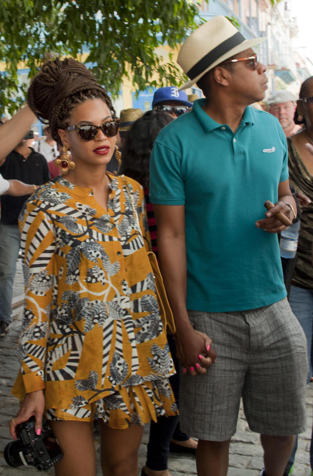 U.S. singer Beyonce and her husband, rapper Jay-Z, tour Old Havana, Cuba, Thursday, April 4, 2013. R&B's power couple is in Havana on their fifth wedding anniversary. (AP Photo/Ramon Espinosa)