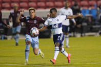 Vancouver Whitecaps forward Deiber Caicedo (7) controls the ball as Colorado Rapids midfielder Cole Bassett (26) defends in the second half of an MLS soccer game, Sunday, May 2, 2021, in Sandy, Utah. (AP Photo/Rick Bowmer)