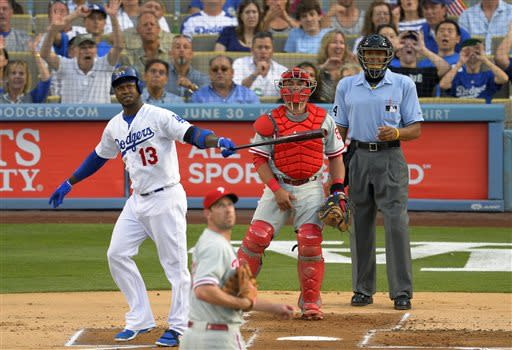 Los Angeles Dodgers' Hanley Ramirez, left, hits a three-run home run as Philadelphia Phillies starting pitcher Cliff Lee, second from left, looks on along with catcher Carlos Ruiz, second from right, and home plate umpire CB Bucknor during the first inning of their baseball game, Saturday, June 29, 2013, in Los Angeles. (AP Photo/Mark J. Terrill)