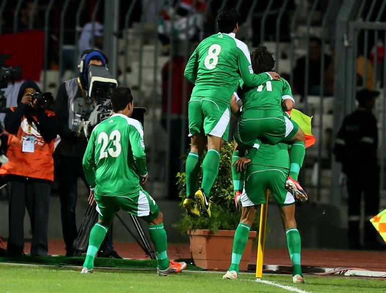 Iraq players celebrate after scoring a goal against Bahrain during the two teams semi final match in the in the 21st Gulf Cup in Manama, January 15, 2013. Iraq will take on the United Arab Emirates in the final of the 21st Gulf Cup on Friday after both sides -- the only two of eight in the tournament to be coached by locals -- advanced through the group stage undefeated