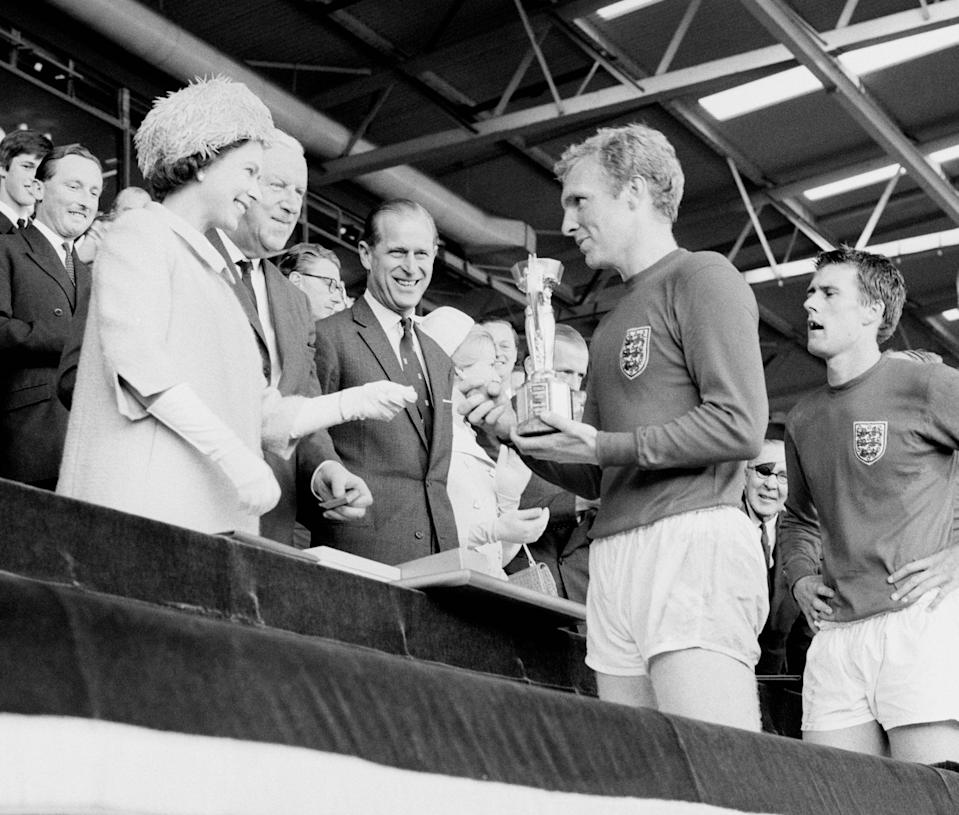 The Queen presents Bobby Moore with the World Cup in 1966 (PA Wire)