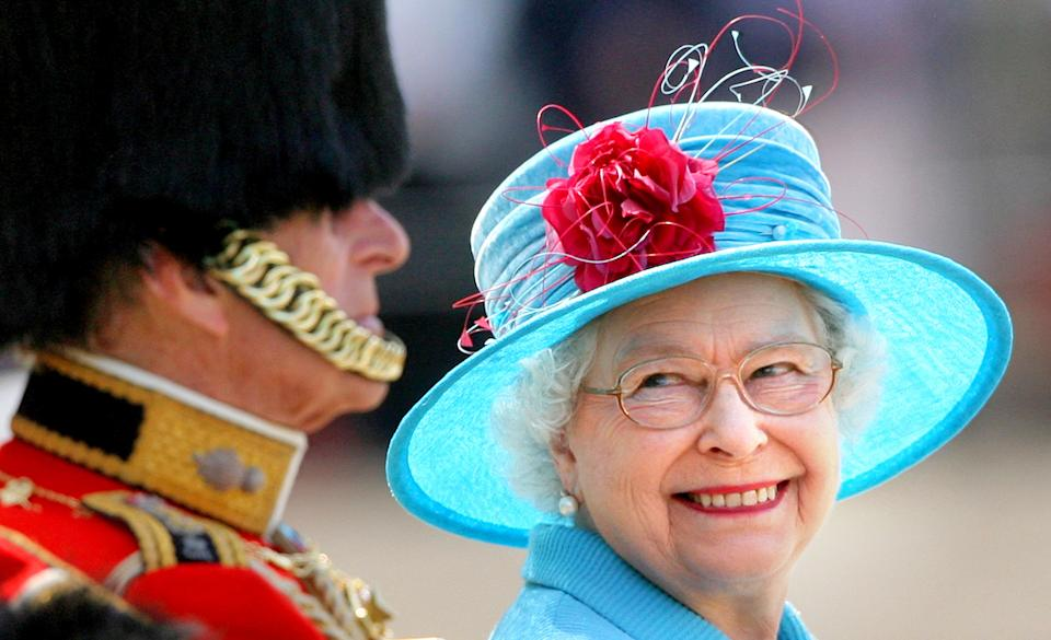 The Queen beams at her husband Duke of Edinburgh during the carriage procession. Prince Philip is dressed in his uniform as Colonel of the Grenadier Guards. (PA Images)