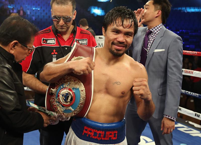 Manny Pacquiao celebrates his victory over Timothy Bradley at the MGM Grand Garden Arena on April 12, 2014 in Las Vegas, Nevada