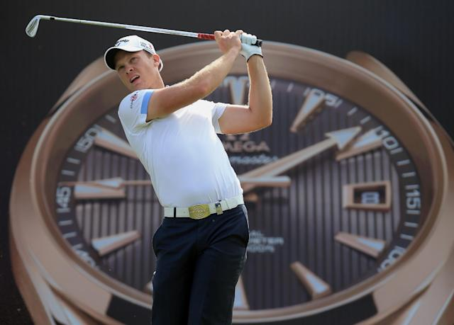 Danny Willett of England plays a shot during the second round of the Dubai Desert Classic golf tournament in Dubai, United Arab Emirates, Friday Jan. 31, 2014. (AP Photo)