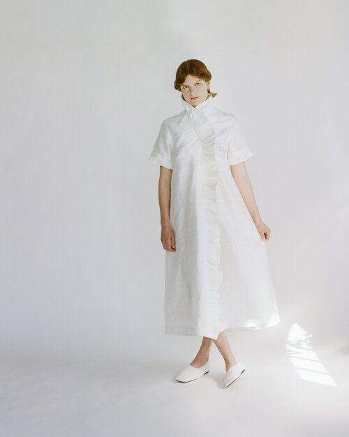 """<p>Designed and created in London, Cawley Studio is a celebration of British craftsmanship by way of shirred silk Dupion dresses, Irish linen shirts and sheepskin hats. While items on their own shop are made-to-order, Cawley Studio has released a selection of designs ready to buy on Matches Fashion now.</p><p><a class=""""link rapid-noclick-resp"""" href=""""https://www.matchesfashion.com/womens/designers/cawley-studio?is=Cawley+Studio"""" rel=""""nofollow noopener"""" target=""""_blank"""" data-ylk=""""slk:SHOP CAWLEY STUDIO NOW"""">SHOP CAWLEY STUDIO NOW</a></p>"""