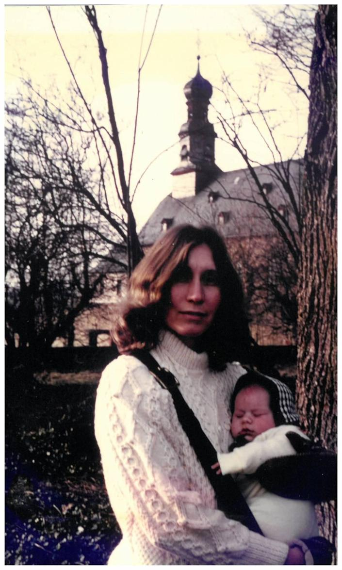 Patricia Peterson holding Clayton Peterson in Rockenberg, Germany in 1974