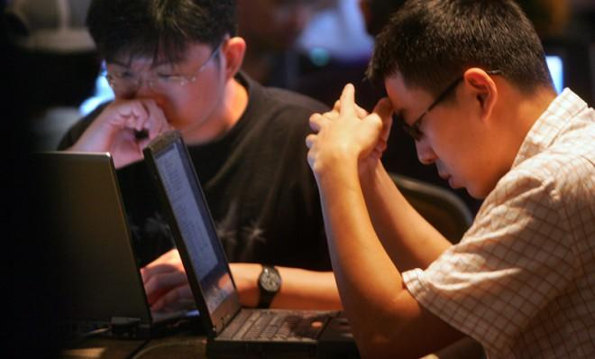 Two young men participate in the annual Hack-In-The-Box Security Conference in Malaysia, Oct. 6, 2004.