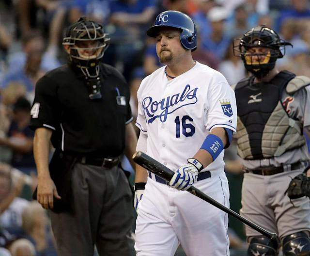 Kansas City Royals' Billy Butler walks to the dugout after striking out during the fourth inning of a baseball game against the Detroit Tigers on Friday, July 11, 2014, in Kansas City, Mo. (AP Photo/Charlie Riedel)