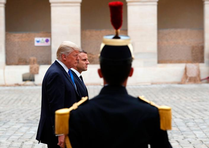 Trump and Macron review troops during a welcome ceremony.