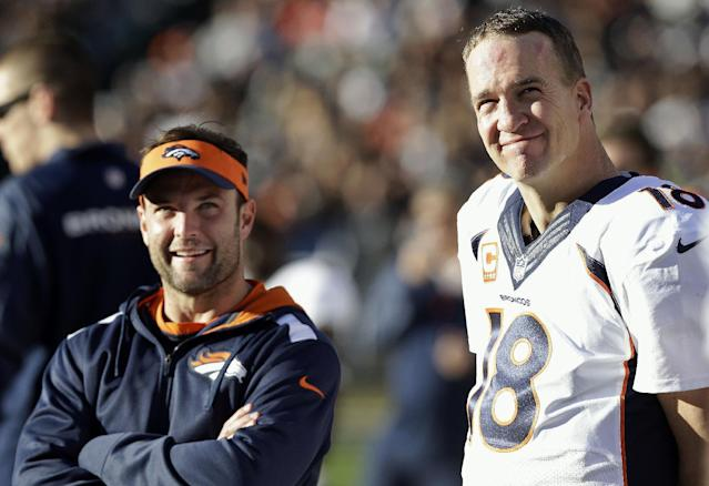 Denver Broncos quarterback Peyton Manning (18) stands on the sideline with wide receiver Wes Welker during the second half of an NFL football game against the Oakland Raiders, Sunday, Dec. 29, 2013, in Oakland, Calif. (AP Photo/Marcio Jose Sanchez)