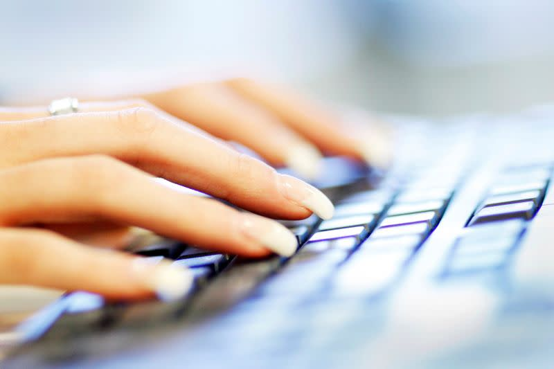 FILE PHOTO: A woman uses a computer keyboard in this photo illustration