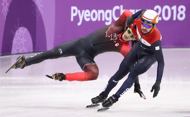 Short Track Speed Skating Events – Pyeongchang 2018 Winter Olympics – Men's 5000m Relay Competition – Gangneung Ice Arena - Gangneung, South Korea – February 13, 2018 - Samuel Girard of Canada falls behind Sjinkie Knegt of Netherlands. REUTERS/Lucy Nicholson TPX IMAGES OF THE DAY
