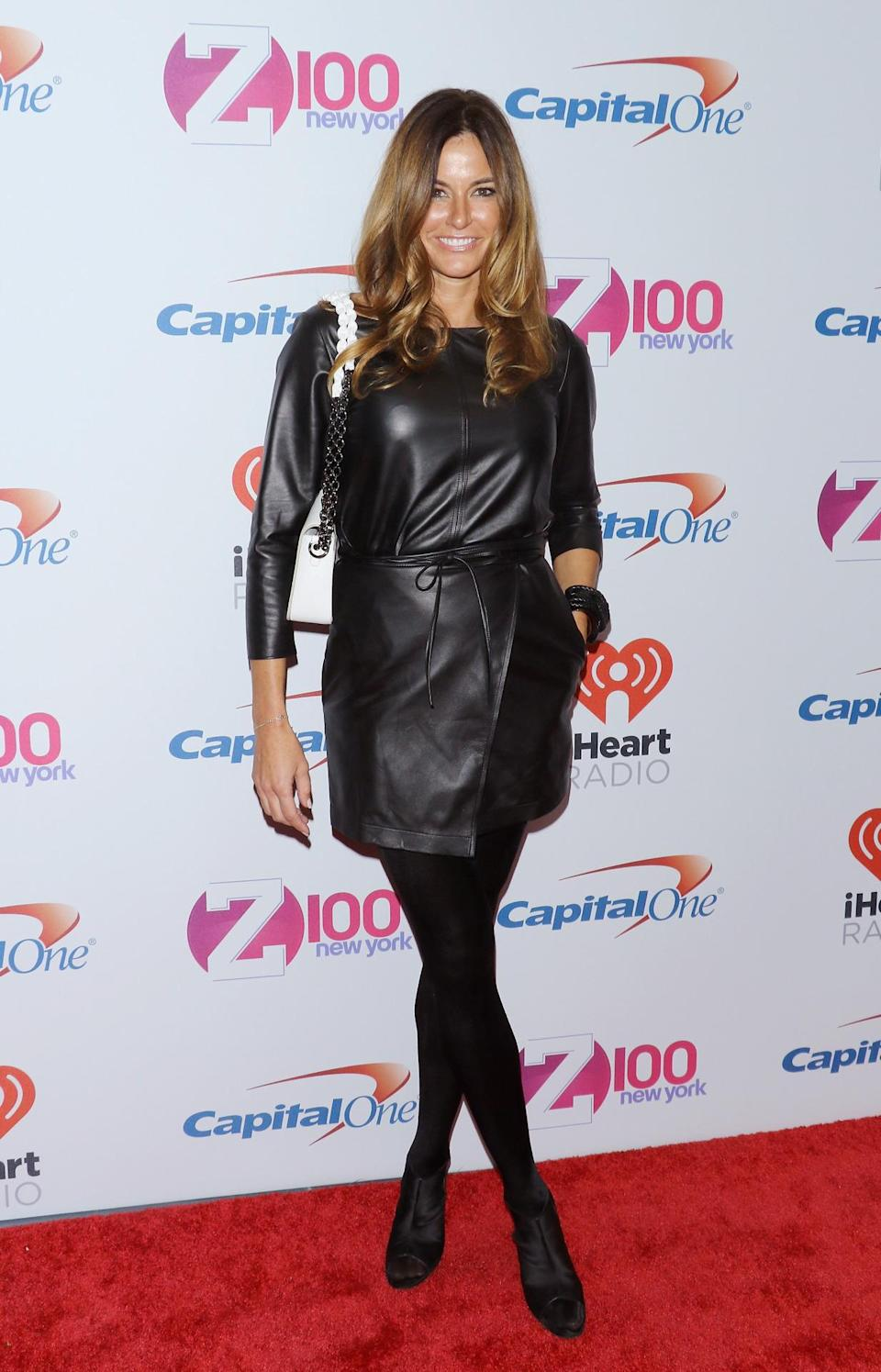 <p>Kelly Bensimon went with head-to-toe black, breaking up her look with a white purse.</p>