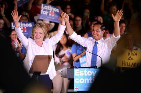"""Democratic U.S. presidential candidate Hillary Clinton waves with U.S. Secretary of Housing and Urban Development Julian Castro at her side during a """"Latinos for Hillary"""" rally in San Antonio, Texas October 15, 2015. Castro endorsed Clinton's campaign for president. REUTERS/Darren Abate"""