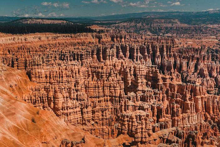 "<p><a href=""https://www.nps.gov/brca/index.htm"" rel=""nofollow noopener"" target=""_blank"" data-ylk=""slk:Bryce Canyon National Park"" class=""link rapid-noclick-resp"">Bryce Canyon National Park</a> won't look like anywhere you've seen before with thousands of their hoodoos — geological structures formed by frosty weather and steam erosion. You'll be looking out into a sea of red, orange, and white rocks — and be sure to check out a collection of natural amphitheaters, too. </p><p>Bryce Canyon is located about 50 miles from Zion National Park.</p><p>How many of these did you know was in the United States? Each of these places is a real-life Photoshopped dream. You won't have to fly across the world to see any of these unreal destinations. Some you can check off your list in one road trip from Arizona, Utah, and California. </p><p>Wherever your next adventure takes you, you won't have to leave the country to see wonders of the world. </p>"