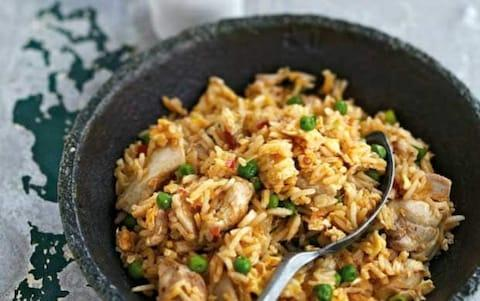 Ken Hom's chicken fried rice recipe - Credit: PROMO GROUP 2011 / MARTIN POPE / CAMERA PRESS