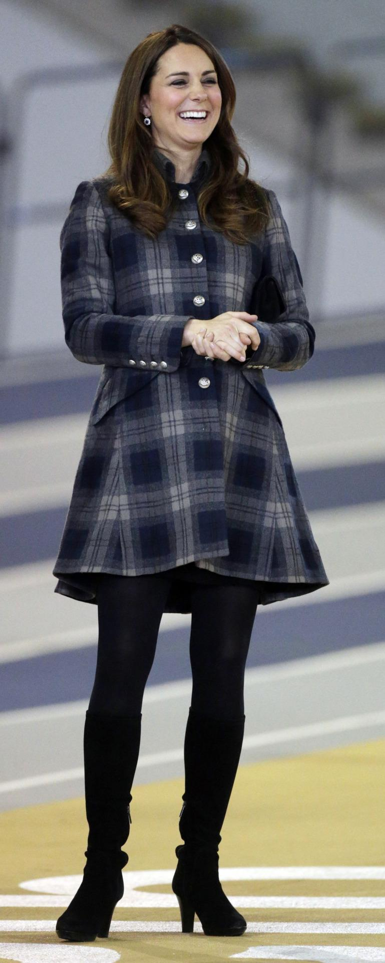 <p>The Duchess spent a day in Scotland dressed in a tartan coat by British label, Moloh. She also wore her trust Aquatalia heeled boots and carried a black suede clutch. </p><p><i>[Photo: PA]</i></p>