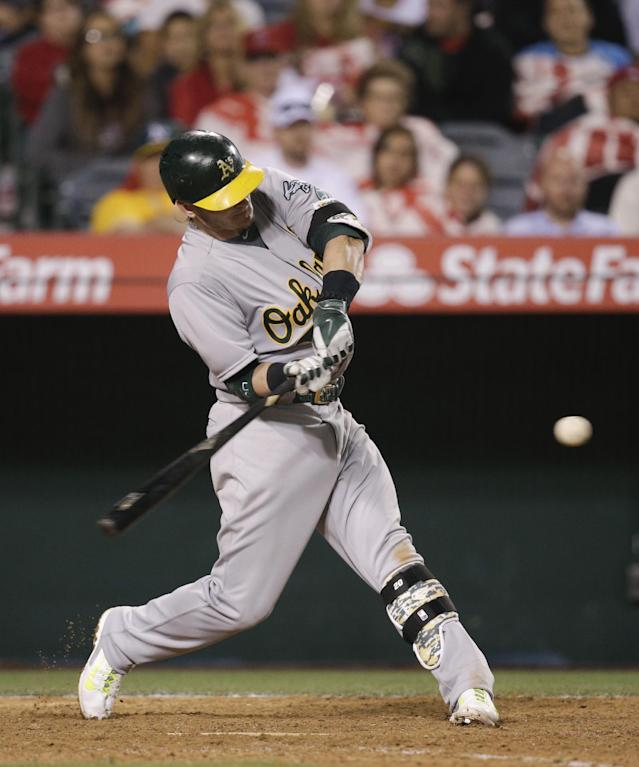 Oakland Athletics' Josh Donaldson hits a RBI-double during the 11th inning of a baseball game against the Los Angeles Angels on Tuesday, April 15, 2014, in Anaheim, Calif. (AP Photo/Jae C. Hong)