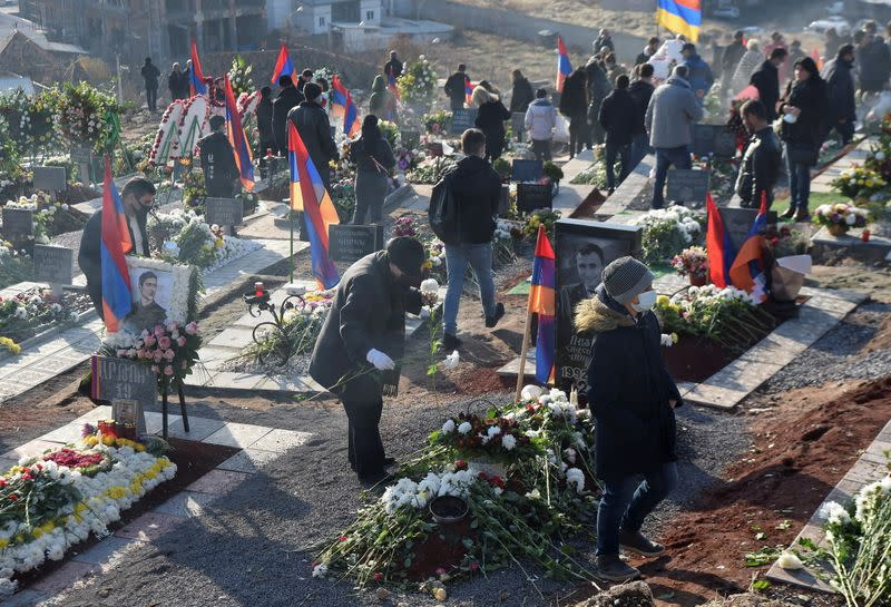 People visit a military cemetery on the day of the Armenian nationwide mourning in Yerevan