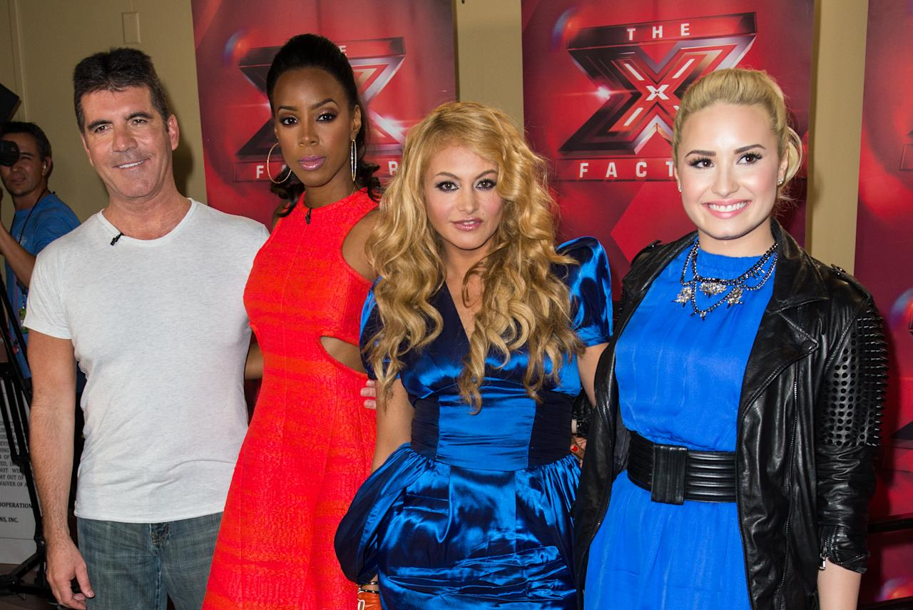 "UNIONDALE, NY - JUNE 20:  Simon Cowell, Kelly Rowland, Paulina Rubio, and Demi Lovato attend ""The X Factor"" Judges press conference at Nassau Veterans Memorial Coliseum on June 20, 2013 in Uniondale, New York.  (Photo by Mike Pont/Getty Images)"
