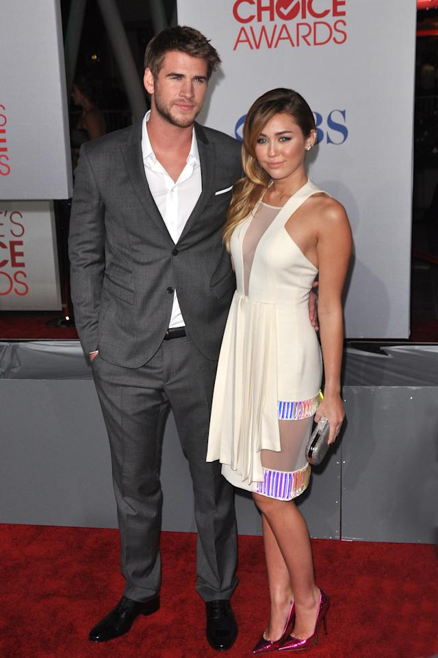 FWD120 Miley Cyrus and Liam Hemsworth attend the People's Choice Awards 2012 in Los Angeles on Wednesday, January 11, 2012. (Fashion Wire Daily/Maria Ramirez)