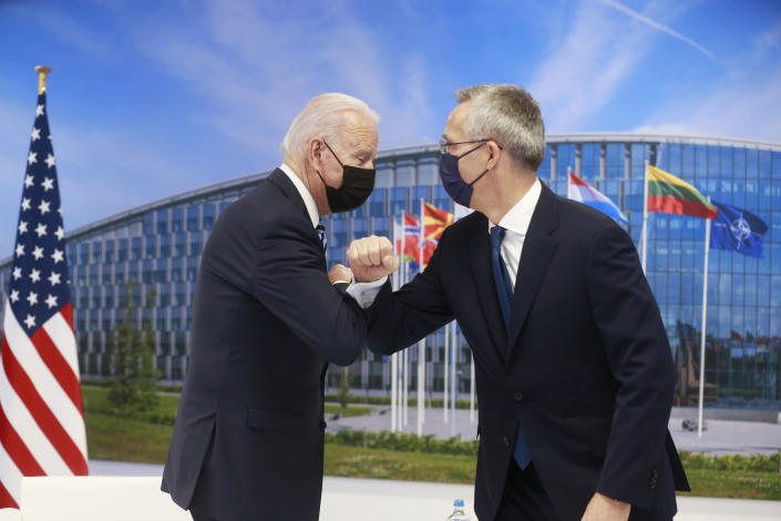 NATO Secretary General Jens Stoltenberg greets U.S. President Joe Biden with an elbow bump prior to a bilateral meeting on the sidelines of a NATO summit at NATO headquarters in Brussels, Monday, June 14, 2021. U.S. President Joe Biden is taking part in his first NATO summit, where the 30-nation alliance hopes to reaffirm its unity and discuss increasingly tense relations with China and Russia, as the organization pulls its troops out after 18 years in Afghanistan. (Stephanie Lecocq, Pool via AP)