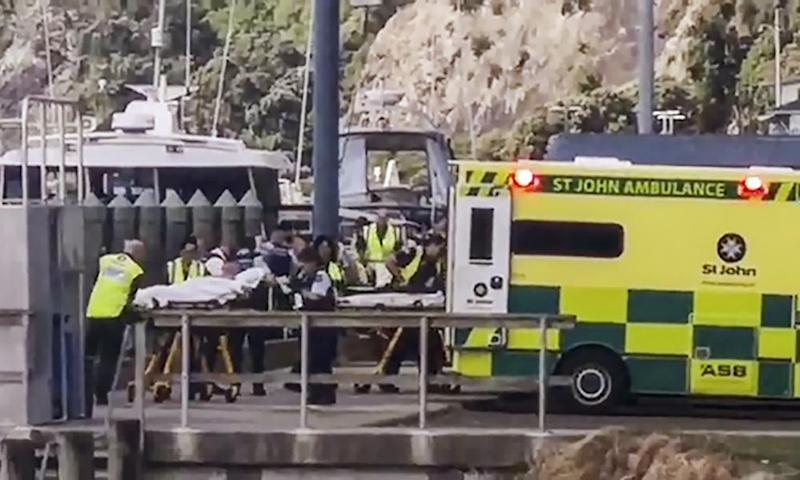 People injured in the White Island volcanic eruption are ferried into waiting ambulances in Whakatane