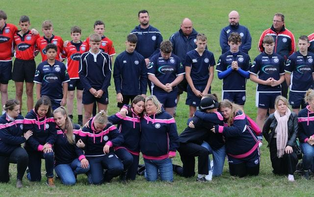 Players observe a minute's silence at East Grinstead rugby club
