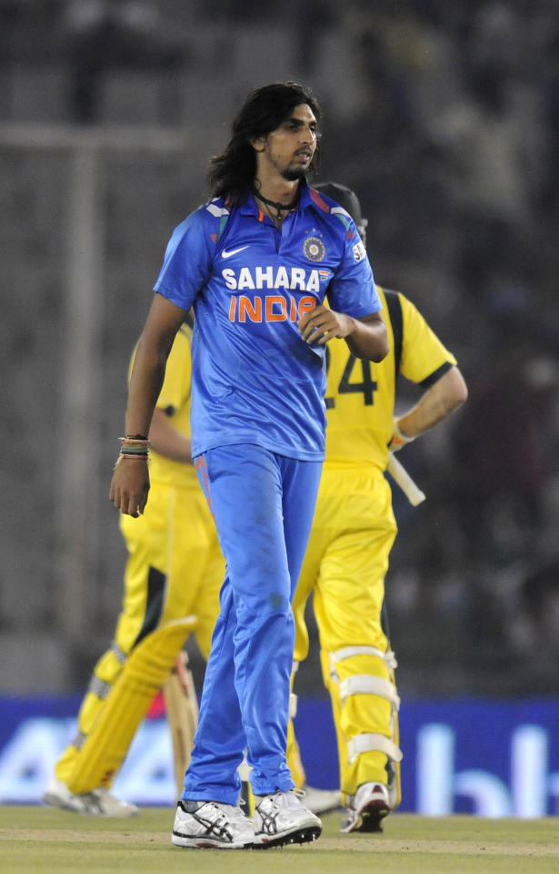 Ishant Sharma of India walks back after an expensive over during the 3rd One Day International (ODI) match in the Star Sports Series between India and Australia held at the PCA International Stadium in Mohali on the 19th October 2013  Photo by Pal Pillai-BCCI-SPORTZPICS  Use of this image is subject to the terms and conditions as outlined by the BCCI. These terms can be found by following this link:  https://ec.yimg.com/ec?url=http%3a%2f%2fsportzpics.photoshelter.com%2fgallery%2fBCCI-Image-terms-and-conditions%2fG00004IIt7eWyCv4%2fC0000ubZaQCkIRgQ&t=1498294197&sig=8ZXGuFXgs9E1B3FTUmg3Mg--~C