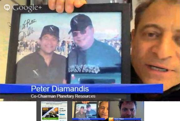 Peter Diamandis displays an autographed photo of himself with William Shatner, during an online videochat, June 25, 2013.