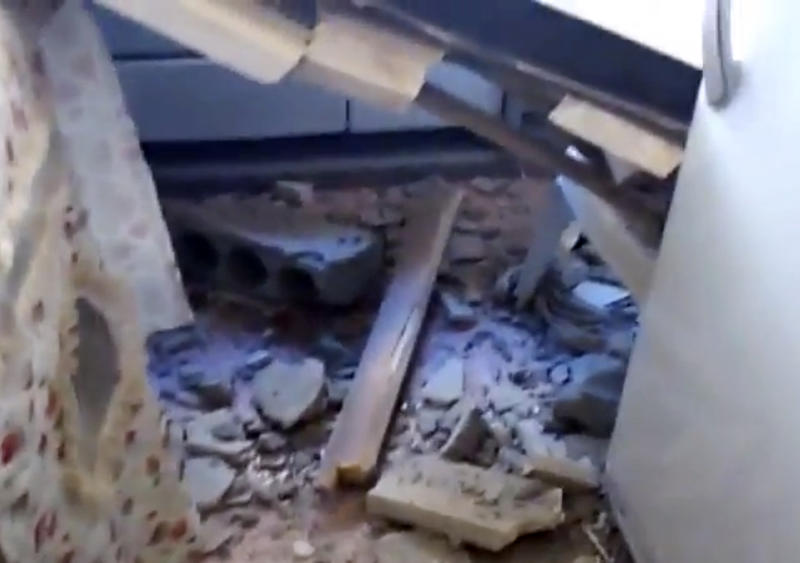 This image made from amateur video released by Shaam News Network and accessed Tuesday, June 12, 2012 purports to show a destroyed building in Deir el-Zour, Syria.(AP Photo/Shaam News Network via AP video)THE ASSOCIATED PRESS CANNOT INDEPENDENTLY VERIFY THE CONTENT, DATE, LOCATION OR AUTHENTICITY OF THIS MATERIAL