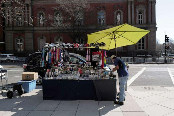 PHOTO: A street vendor sets up his booth near the White House, as more streets have been opened back after lifting some of the security measures, in Washington, D.C., March 14, 2021. (Cheriss May/Reuters, FILE)