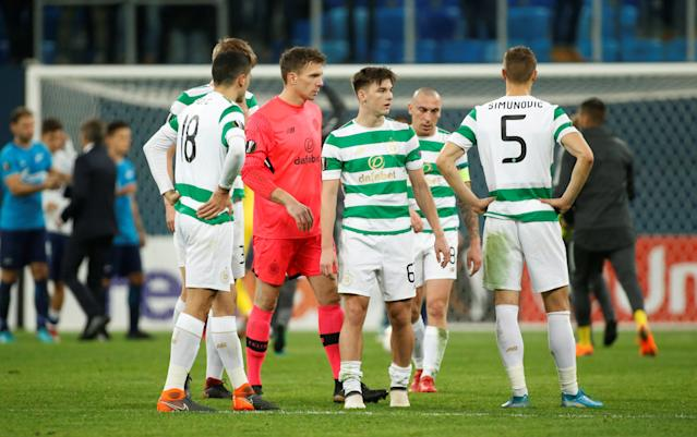 Soccer Football - Europa League Round of 32 Second Leg - Zenit Saint Petersburg vs Celtic - Stadium St. Petersburg, Saint Petersburg, Russia - February 22, 2018 Celtic's Dorus de Vries and Kieran Tierney look dejected after the match REUTERS/Maxim Shemetov