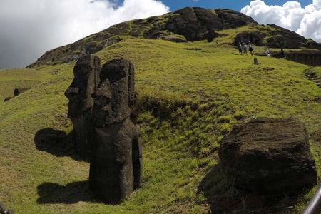 """Statues named """"Moai"""" are seen on a hill at the Easter Island, Chile  February 1, 2019.  REUTERS/Jorge Vega"""