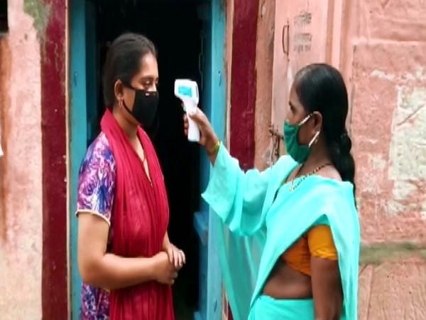 A villager in Ghatne gets her temperature checked. (Photo/ANI)