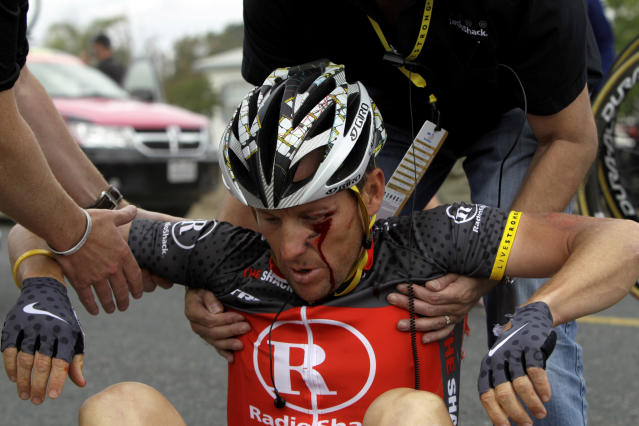 FILE - In this May 20, 2010 file photo, U.S. cyclist Lance Armstrong is helped up after crashing during the fifth stage of the Tour of California cycling race on the outskirts of Visalia, Calif. Just days after Armstrong's doping admission, cycling is set for more damaging revelations as a long-delayed drug investigation finally goes to court in Spain. Seven years after Spanish investigators uncovered one of cycling's most sophisticated and widespread doping rings, some of its central figures will stand trial on Monday, Jan. 28, 2013 in the Operation Puerto case. (AP Photo/Marcio Jose Sanchez, File)