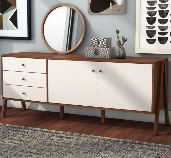 "Though, we're eyeing <a href=""https://www.wayfair.com/furniture/pdp/langley-street-sunset-sideboard-lgly2727.html"" target=""_blank"">this beauty</a> for a stylish, storage-friendly TV stand."