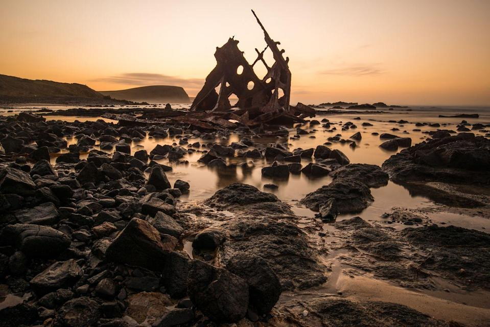"""<p>The wreckage of the S.S. Speke, one of the <a href=""""http://www.humbletrail.com/speke-shipwreck/"""" rel=""""nofollow noopener"""" target=""""_blank"""" data-ylk=""""slk:largest sailing ships"""" class=""""link rapid-noclick-resp"""">largest sailing ships</a> of its time, struck a reef in 1906. Here, the remains that rest on the shore of Phillip Island (Australia) are captured during sunset.</p>"""