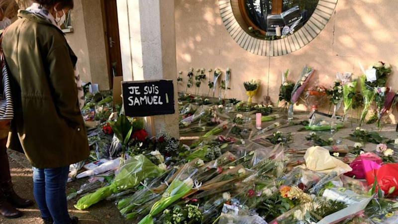 French prosecutors charge two pupils, five adults over slain teacher
