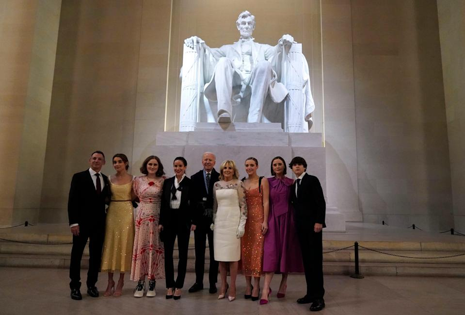 President Joe Biden and first lady Jill Biden pose for a photo with family members at the Celebrating America concert at the Lincoln Memorial in Washington, Wednesday, Jan. 20, 2021, after his inauguration.