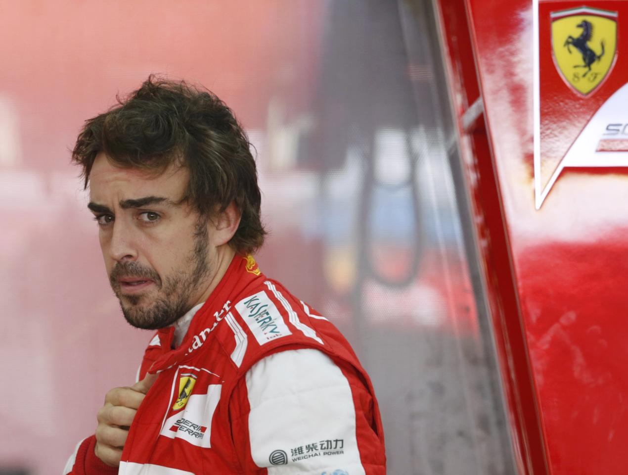 Ferrari Formula One driver Fernando Alonso of Spain looks on during the third practice session of the Korean F1 Grand Prix at the Korea International Circuit in Yeongam, October 5, 2013. REUTERS/Lee Jae-Won (SOUTH KOREA - Tags: SPORT MOTORSPORT F1 TPX IMAGES OF THE DAY)