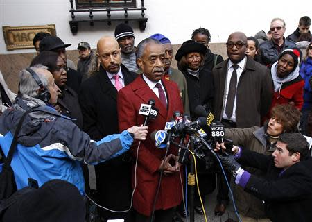 Rev. Al Sharpton speaks to the media outside Macy's department store, after meeting with company officials in New York, November 4, 2013. REUTERS/Adam Hunger