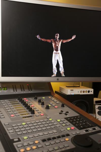 In this photo taken Tuesday, June 12, 2012, a video image of the Tupac Shakur hologram iis displayed on a computer monitor at the Subtractive Studio in Santa Monica, Calif. When Tupac Shakur rose from the stage in the California desert earlier this year, it was not only a jaw-dropping resurrection, but also the beginning of a new form of live entertainment. Stars wield extensive control over how their names, voices and images are used after they die through likeness, trademark and copyright protections, and now holograms offer them yet another consideration. (AP Photo/Damian Dovarganes)