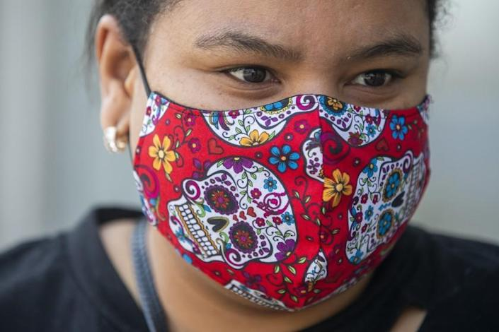 HIGHLAND PARK, CA - JULY 16: Brandy Muniz, 31, of Highland Park is walking on the sidewalk wearing her mask on Friday, July 16, 2021 in Highland Park, CA. Starting Saturday night, residents will again be required to wear masks in indoor public spaces, regardless of their vaccination status. Just a month ago, Los Angeles County and the rest of California celebrated a long-awaited reopening, marking the tremendous progress made in the battle against COVID-19 by lifting virtually all restrictions on businesses and other public spaces. Now, the coronavirus is resurgent, and the nation's most-populous county is scrambling to beat back the pandemic's latest charge.(Francine Orr / Los Angeles Times)
